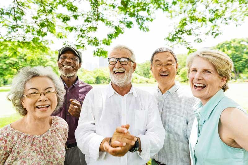 Group of happy elderly people outdoors